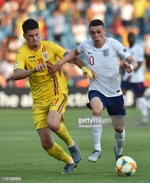 Tudor Baluta of Romania and Phil Foden of England in action during the 2019 UEFA U-21 Group C match between England and Romania at Dino Manuzzi...