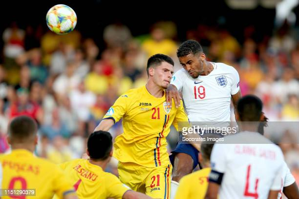 Tudor Baluta of Romania U21 Dominic CalvertLewin of England U21 during the EURO U21 match between England v Romania at the Orogel StadiumDino Manuzzi...