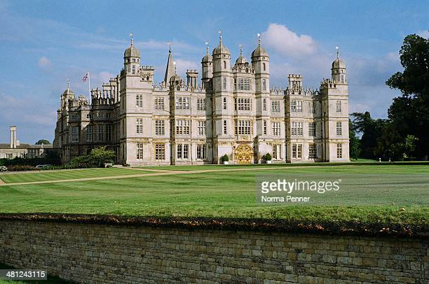 Tudor mansion built by Queen Elizabeths Lord High Treasurer in 1555 stands uninterrupted against a rich lawn and blue sky The backdrop to the...