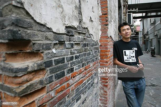 Tudou Chief Executive Officer Gary Wang poses for a photograph outside his offices on September 21 2007 in Shanghai China Tudoucom is the YouTube of...