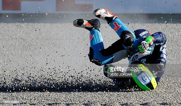 Tuenti Movil HP40's Spanish rider Aleix Espargaro crashes during the Moto2 qualifying session of the Valencia Grand Prix at Ricardo Tormo racetrack...
