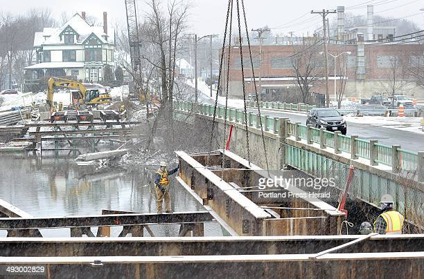 Tues Jan 31 2012 Reed Reed construction workers construct a temporary bridge across the Presumpscot river in Westbrook that will allow traffic to...