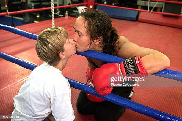 Tuesday 10/3/2000 Simi Valley CA – DIGITAL IMAGE – Boxer Alicia Doyle greeting Thomas Bowers who her little friend who was waiting for his boxing...