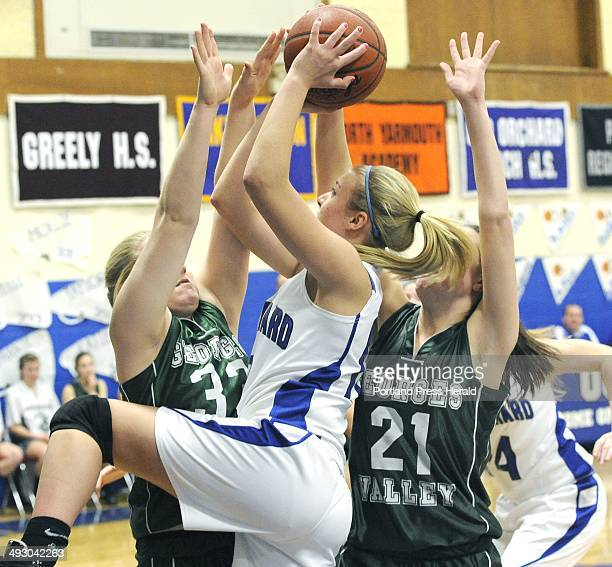 Tuesday 2/14/11 OOB's Gillian Foss shoots the ball over Georges Valley Kennadi Grover left and Colleen Haskell as Old Orchard HS girls basketball...