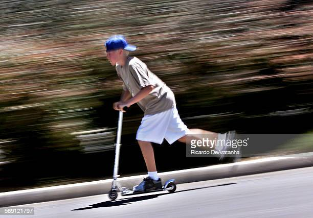 Tuesday 7/18/2000 Thousand Oaks CA –– Kyle Johnson of Thousand Oaks hidding his scooter in parking lot of Teen Center