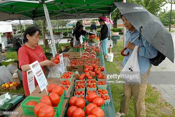 Tuesday - East York Civic Centre Farmers Market 10 am - 2 pm 1. Irene Forget buys homemade cookies from Alanna Hill, whose family owns Hillsview Farm...