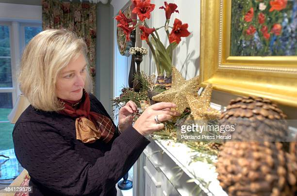 Marie Caswell is a designer who has decorated the mantle of Jane and Jeff Flynn's Cape Elizabeth home She uses dried and artficial flowers pine cones...
