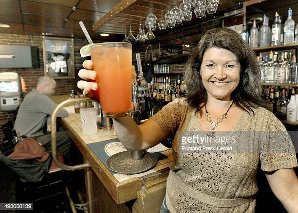 TuesJune 2012 Rosie's bartender Barbi Asali mixes a tequila sunrise