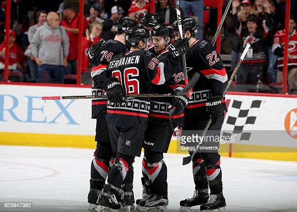 Tuevo Teravainen of the Carolina Hurricanes is congratulated by teammates Sebastian Aho Jaccob Slavin and Brett Pesce after scoring a goal during an...