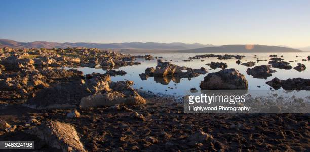 tufa formations and silvery salty water in the early morning sun - highlywood fotografías e imágenes de stock