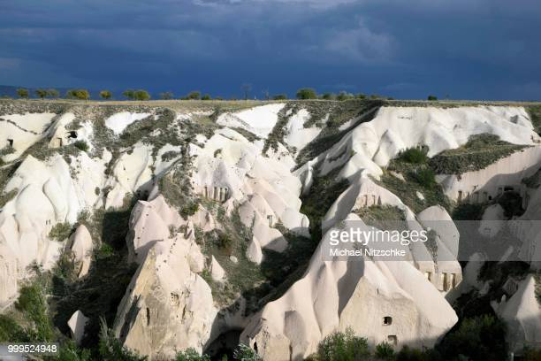 tufa formations, pigeon valley, guevercinlik, nevsehir province, cappadocia, turkey - central anatolia stock photos and pictures