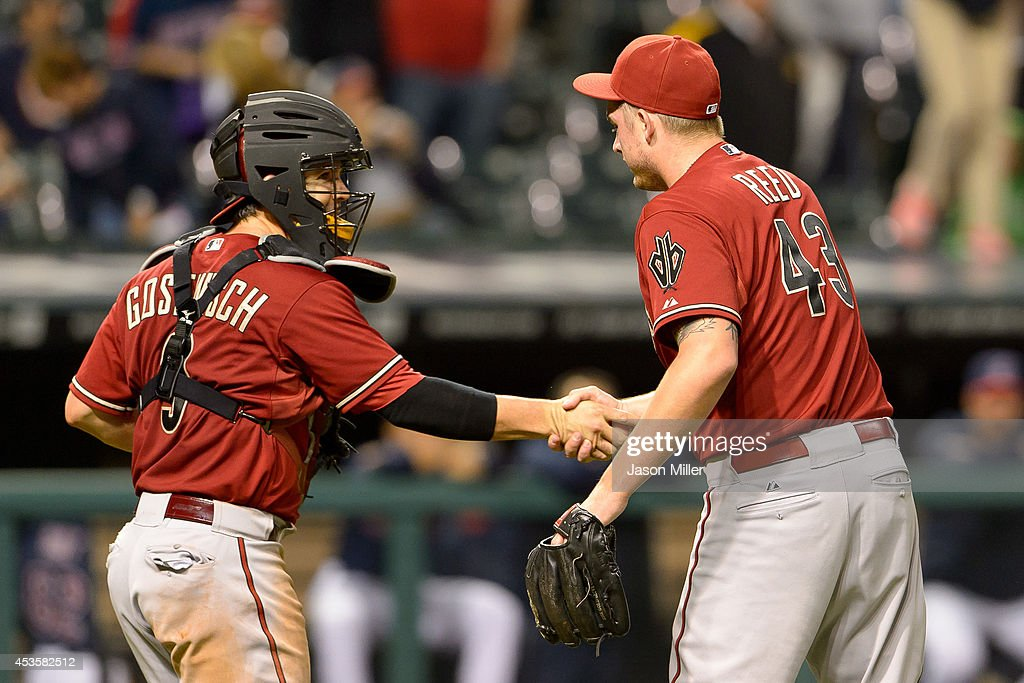Tuffy Gosewisch #9 celebrates with closing pitcher Addison Reed #43 of the Arizona Diamondbacks after the Diamond Backs defeated the Cleveland Indians at Progressive Field during the second game of a double header on August 13, 2014 in Cleveland, Ohio. The Diamond Backs defeated the Indians 1-0 in 12 innings.