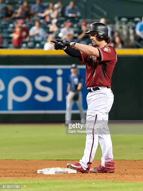 Tuffy Gosewisch of the Arizona Diamondbacks signals to the dugout after a ninth inning double in the MLB game against the San Diego Padres at Chase...