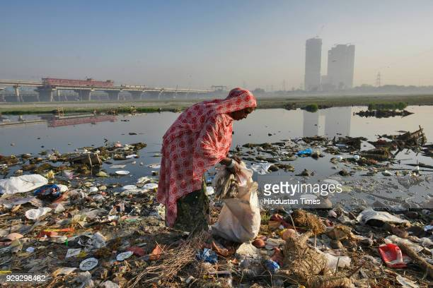 Tufia Khatun collects scraps at Yamuna bank on March 8 2018 in New Delhi India Khatun is a ragpicker and mother of three boys and four girls...