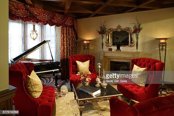 tufted red chairs surround coffee table in living room - image stock pictures, royalty-free photos & images