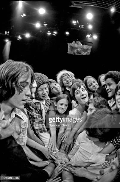 Tufts Arena Theatre Magic Circle players pull together in a hands-on show of solidarity, Medford, Massachusetts, late 1970s.