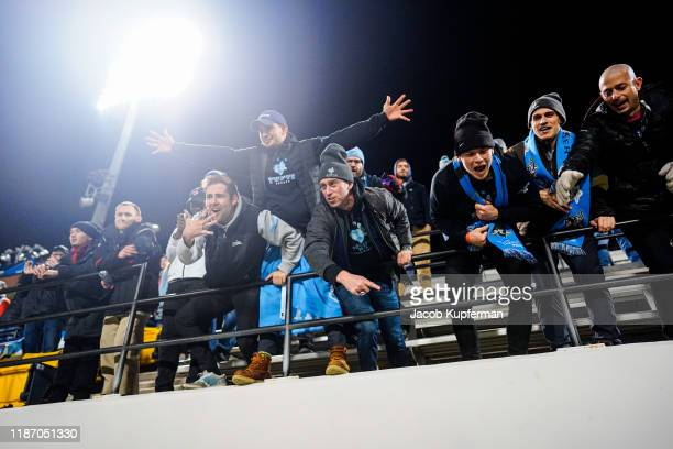Tufts Jumbos fans celebrate after their win during the Division III Men's Soccer Championship held at UNCG Soccer Stadium on December 7 2019 in...