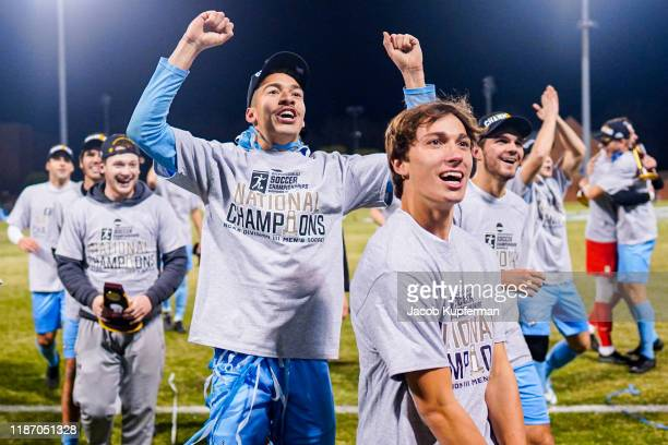 Tufts Jumbos players celebrate after their win during the Division III Men's Soccer Championship held at UNCG Soccer Stadium on December 7 2019 in...