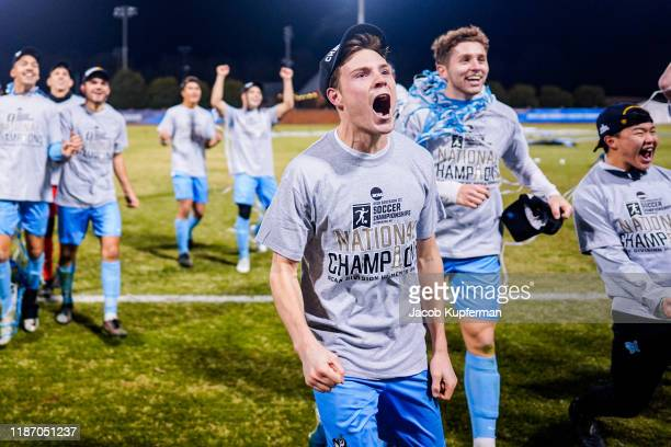 Tufts Jumbos players celebrate after their win in the Division III Men's Soccer Championship2 held at UNCG Soccer Stadium on December 7 2019 in...