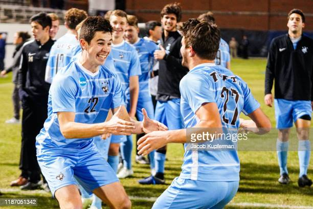 Tufts Jumbos players react after their win during the Division III Men's Soccer Championship held at UNCG Soccer Stadium on December 7 2019 in...