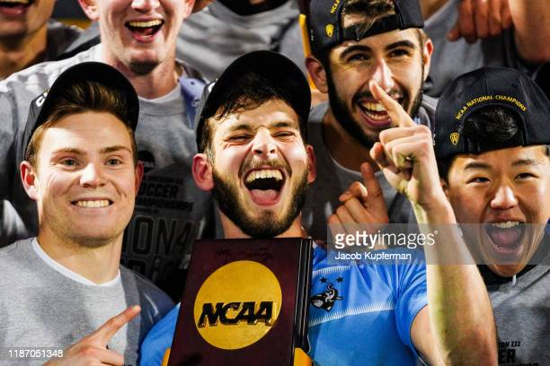 Tufts Jumbos players with the trophy after their win during the Division III Men's Soccer Championship held at UNCG Soccer Stadium on December 7 2019...