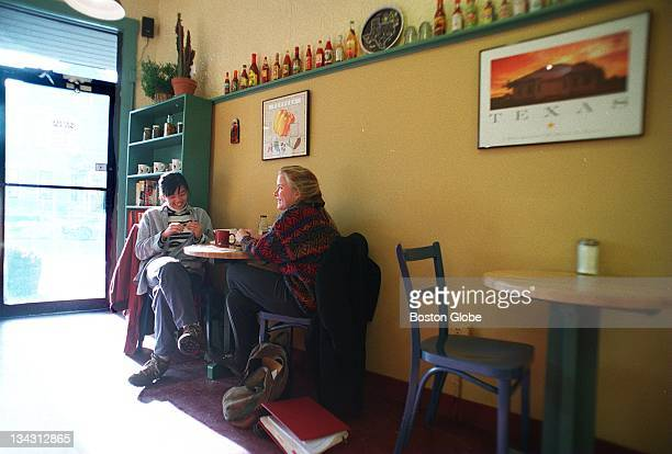 Tufts University graduate students Lulu Young and Sarah McGrath discuss metaphysics at Salt and Pepper Coffee Shop in Somerville Mass