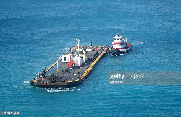tug boat and fuel barge - barge stock photos and pictures