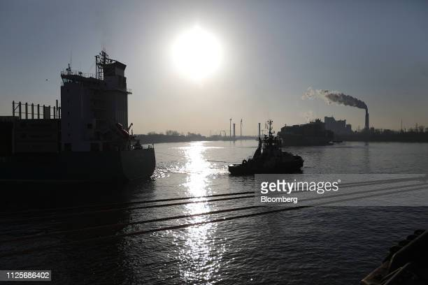 A tug boat assists the Budapest Bridge container vessel on arrival at the HHLA Container Terminal Altenwerder in the port of Hamburg in Hamburg...