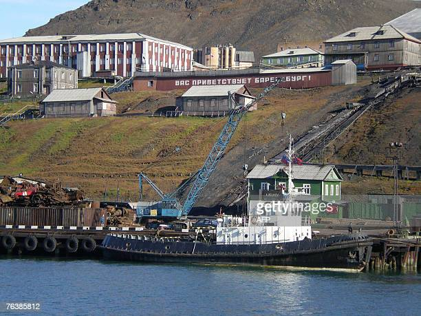 A tug boat is docked in the waters off the Russian mining community of Barentsburg in the Norwegian Arctic archipelago of Svalbard 23 August 2007 A...