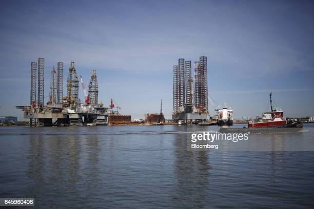 Tug boat passes in front of Ensco Plc oil drilling platforms at the Port of Galveston in Galveston, Texas, U.S., on Thursday, Feb. 16, 2017. The U.S....