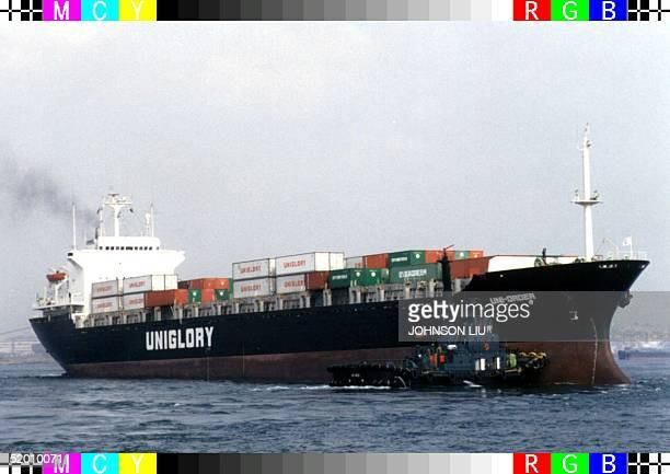 A tug boat pilots the Uniorder a Panamaregistered container ship out of Taiwan's southern port of Kaohsiung 24 April The freighter was the first...