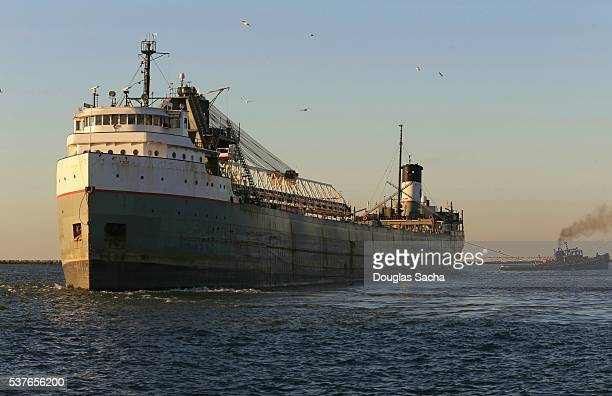 Tug Boat pulls a Freight ship