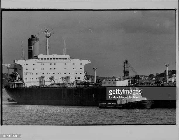 Tug boats bringing in the huge tanker Ampol Sarel Sydney Harbour October 26 1983