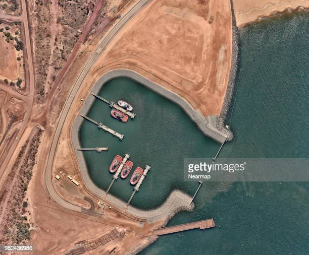 tug boats in harbour - iron ore stock photos and pictures