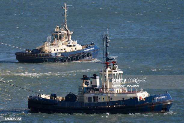 Tug boats in the water at the Port of Southampton on February 10 2019 in Southampton England The Port of Southampton is a passenger and cargo port in...