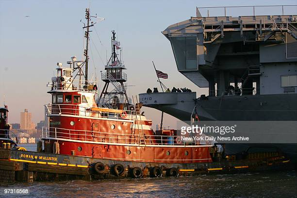 Tug boats prepare to pull the USS Intrepid away from Pier 86 on the West Side of Manhattan so it can make the trip to Bayonne NJ where it will...