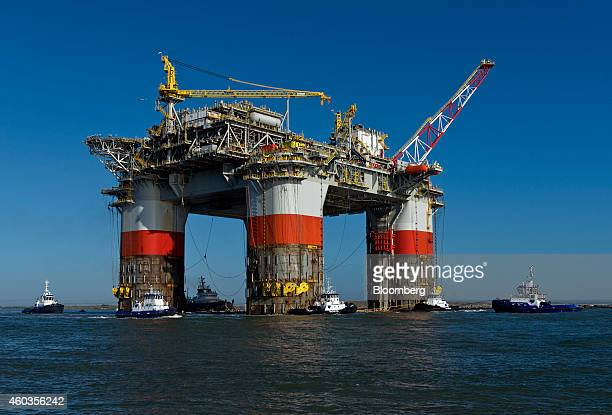Tug boats transport the Chevron Corp Jack St Malo semisubmersible drilling and production platform to the Gulf of Mexico from Kiewit Offshore...