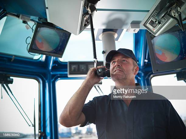 tug captain speaking on radio - ship stock pictures, royalty-free photos & images