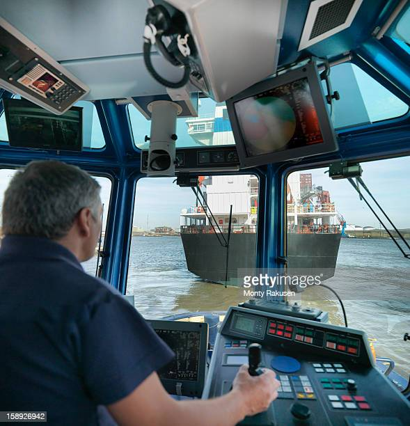 Tug captain steering tug