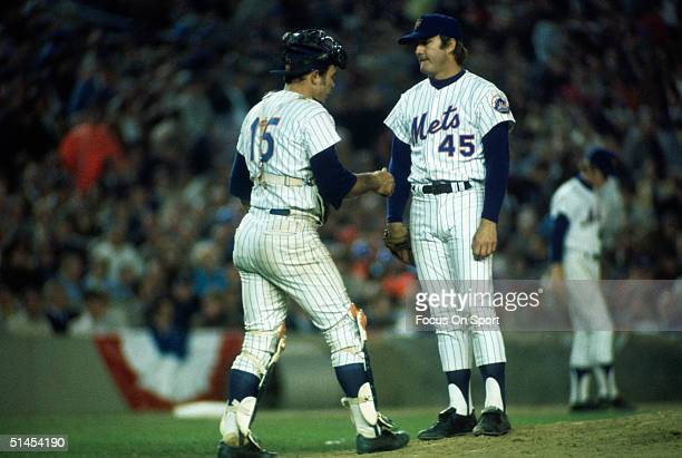 Tug McGraw catcher and pitcher Jerry Grote of the New York Mets meet and talk on the mound during the World Series against the Oakland Athletics at...