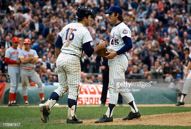 Tug McGraw of the New York Mets talks with catcher Jerry Grote during an Major League Baseball game against the Cincinnati Reds circa 1970 at Shea...