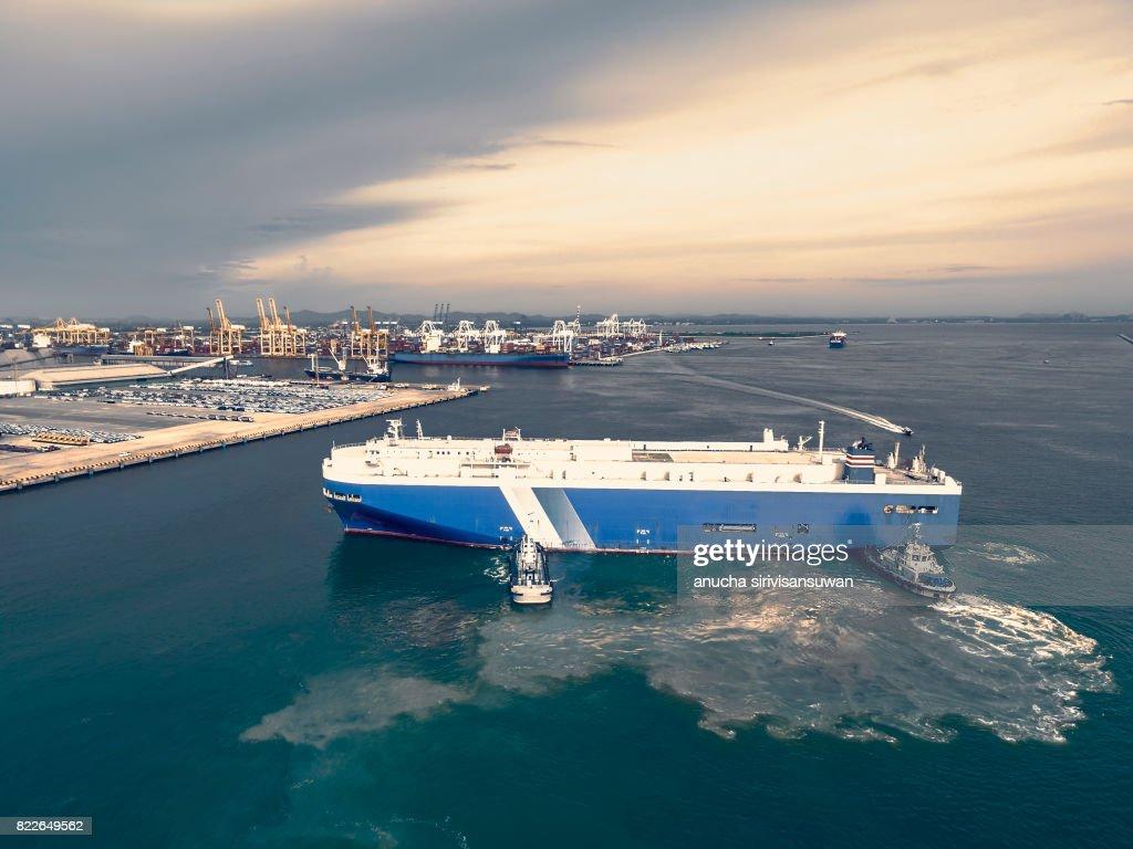 tug push cargo ship dock car . : Stock Photo