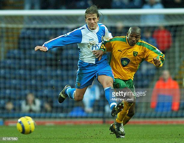 Tugay of Blackburn and Damien Francis of Norwich challenge for the ball during the Barclays Premiership match between Blackburn Rovers and Norwich...