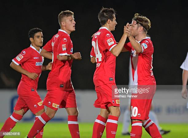 Tugay Uzan and Steven Skrzybski of 1 FC Union Berlin celebrate during the friendly match between FC Strausberg and 1 FC Union Berlin on october 9,...