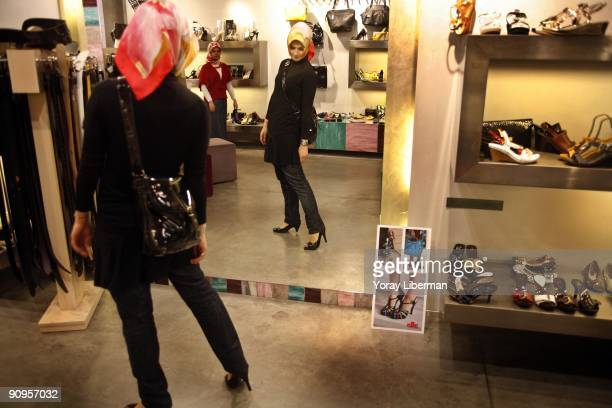 Tugba Gul Bagatir a young head scarfed Muslim woman shops on the main street of Istanbul modern city center on April 21 2008 in Istanbul Turkey The...