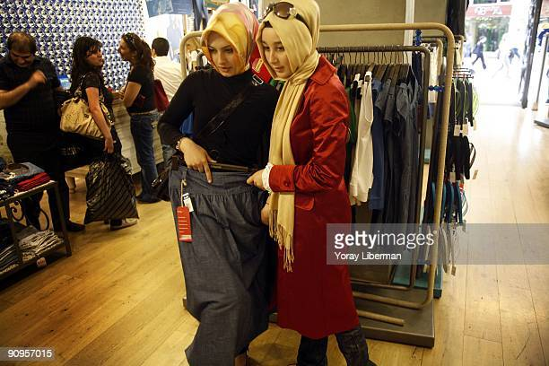 Tugba Gul Bagatir and Zehra Gunzel shop on the main street of Istanbul modern city center on April 21 2008 in Istanbul Turkey The word 'Tesettur' in...