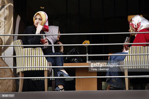 Tugba Gul Bagatir with her friends seated in a cafe on the main street of Istanbul modern city center on April 21 2008 in Istanbul Turkey The word...