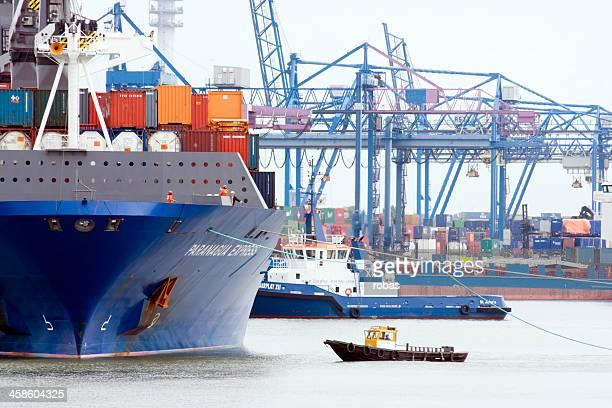 tugboat at tanker in rotterdam harbor - haven stockfoto's en -beelden