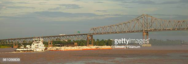 tugboat, barges laden with rock approach bridge - timothy hearsum stock-fotos und bilder