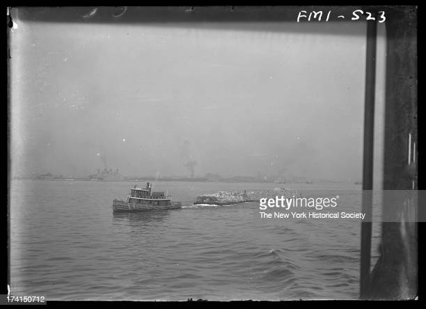 Tugboat 'Dr George J Moser' garbage scows Ellis Island in distance New York New York 1908